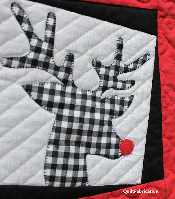 black and white check reindeer applique on Reindeer Wreath quilt by QuiltFabrication