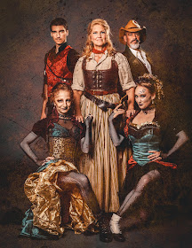 IN REVIEW: soprano AMY COFIELD as Minnie (center) and members of PHANTASMAGORIA in Opera Orlando's February 2020 production of Giacomo Puccini's LA FANCIULLA DEL WEST [Photograph by Javier Vladimir, © by Opera Orlando]