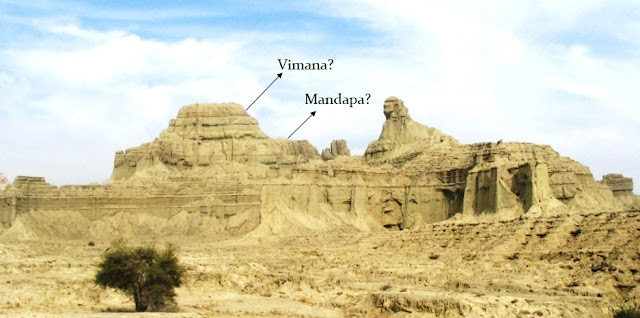 The Balochistan Sphinx reclines in front of a temple-like structure.