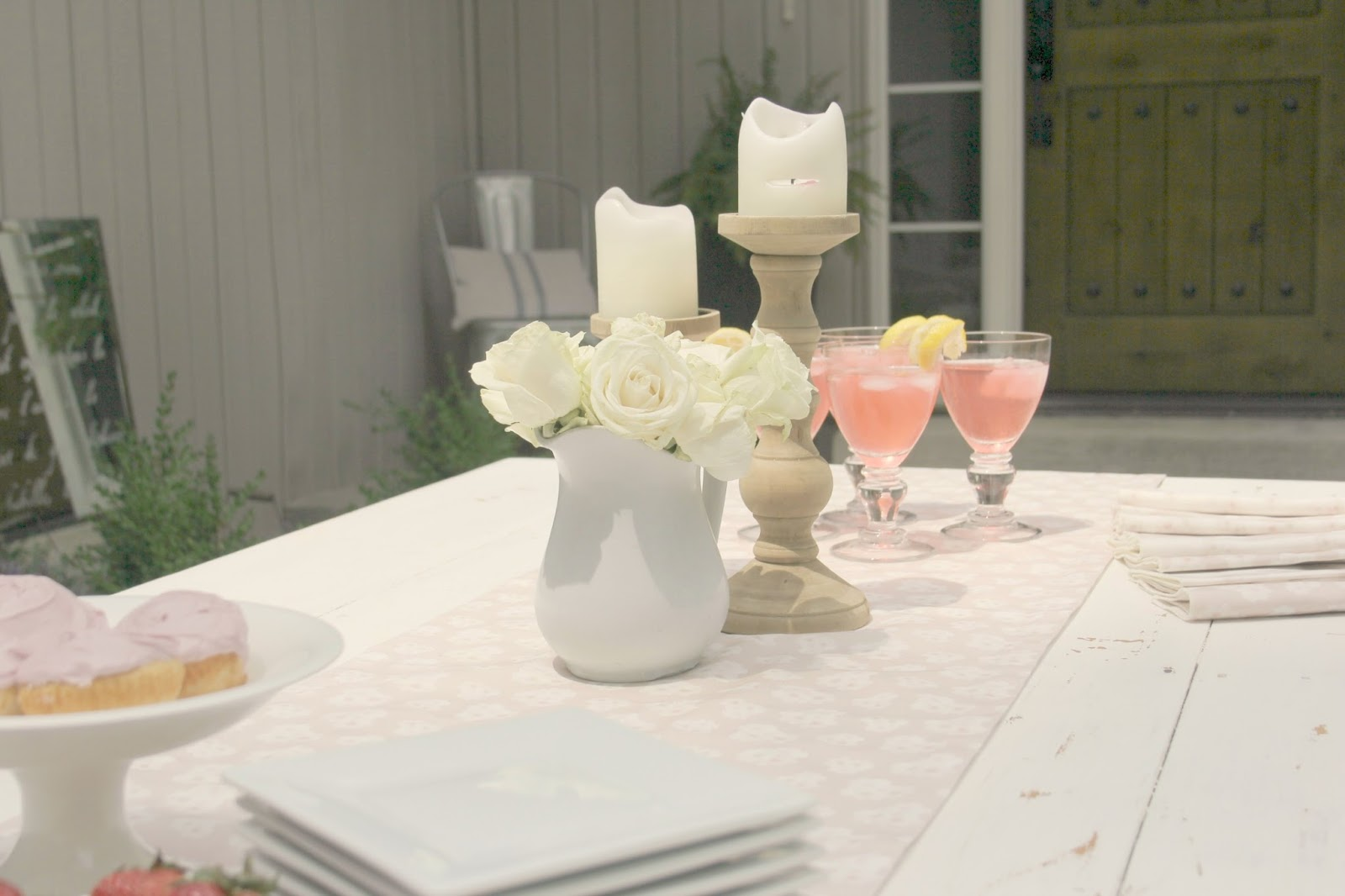White farm table set with cupcakes and cocktails - Hello Lovely Studio