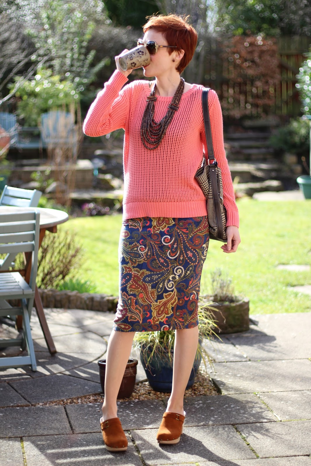 Fake Fabulous | Paisley pencil skirt, coral jumper, tweed bag and tan clogs.