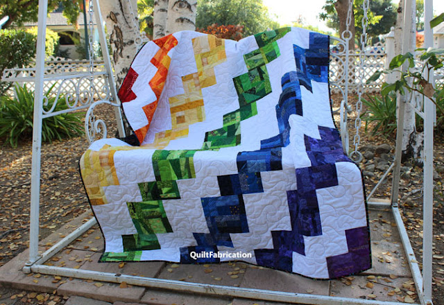 rainbow of colors cascading down the Celilo quilt by QuiltFabrication