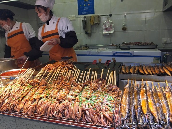 octopus and fish snack on Jinli Old Street in Chengdu, China