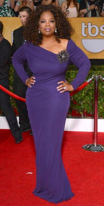 Oprah Winfrey in a dark purple Badgley Mischka dress at the SAG Awards 2014