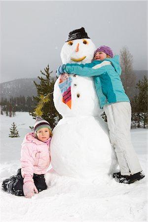 snowman with happy children