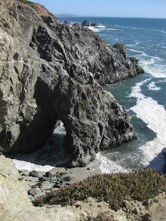 Natural arch at the water's edge, Bodega Head, California