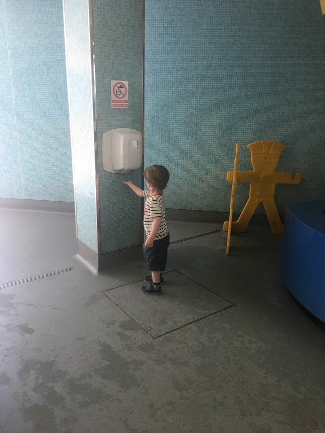 Our-weekly-journal-26th-June-2017-toddler-at-hot-air-hand-dryer-at-Techniquest-Cardiff-Bay