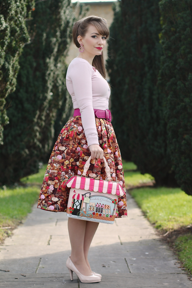 Hell Bunny Paloma pink cardigan, Victory Parade chocolate print skirt and Vendula London Chocolatier grab bag