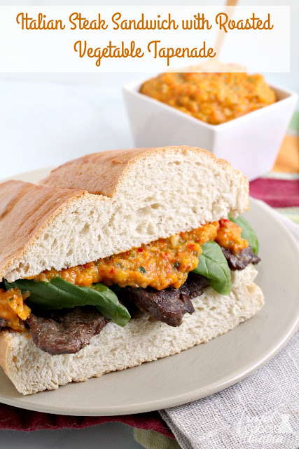 This farmers market inspired Italian Steak Sandwich is slathered in a rich & flavor packed roasted vegetable tapenade & topped with fresh basil leaves.