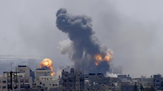 Gaza-Israel hostilities flare with rocket attacks and air strike