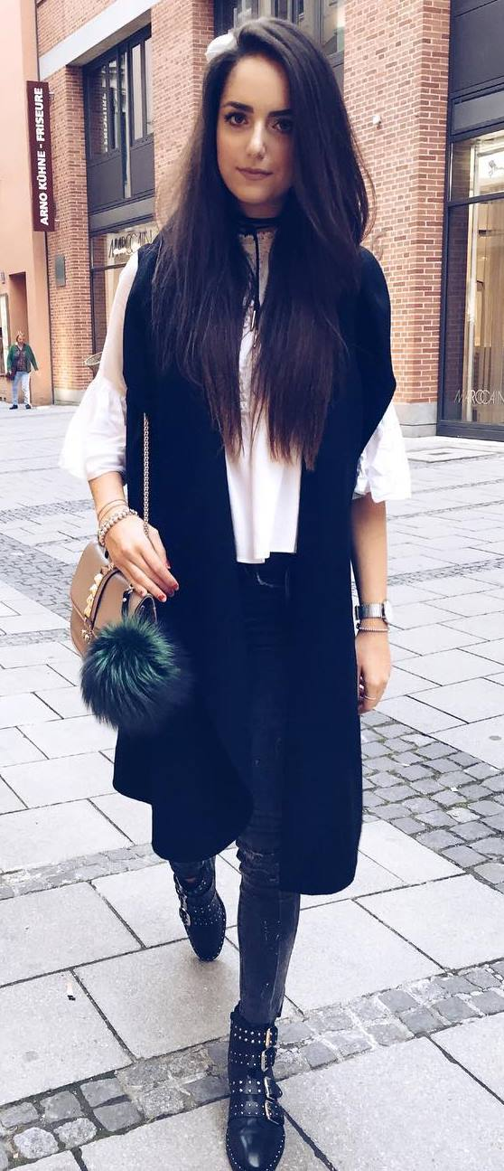 beautiful fall outfit idea : white blouse + black long vest + bag + skinnies + boots