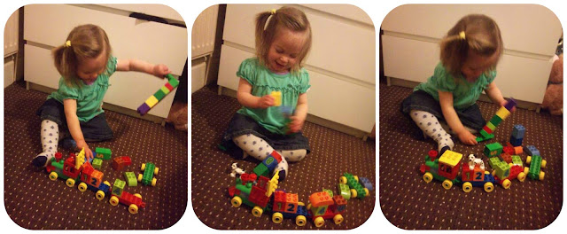 toddler playing with LEGO DUPLO Number Train