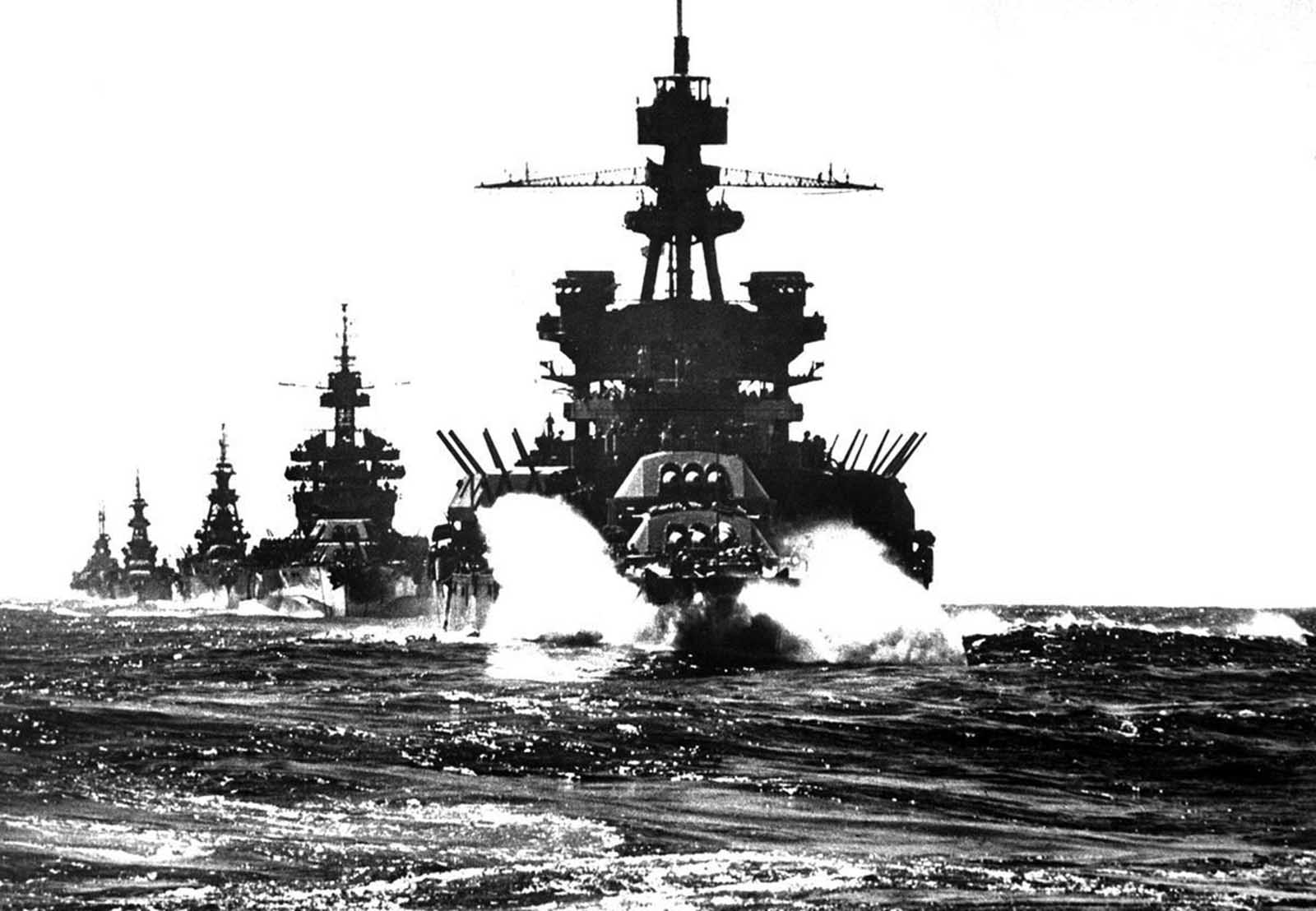 The battleship USS Pennsylvania, followed by three cruisers, moves in line into Lingayen Gulf preceding the landing on Luzon, in the Philippines, in January of 1945.
