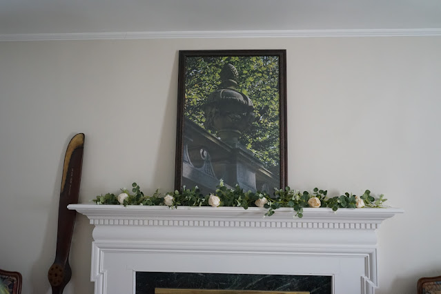 Mantel decorated with rose garland