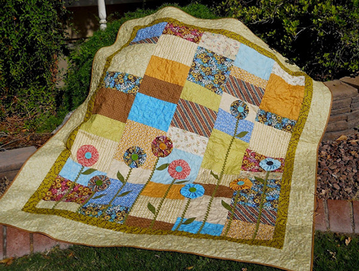 Lulu's Yoyos Quilt by Julie Fisher of Polka Dot Quilter, The Pattern designed by Brenda & Bonnie Bailey from Pie Plate Patterns