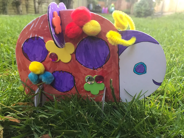 The completed cardboard 3D ladybird from Rainbow Designs on the grass