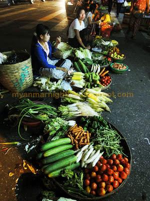 Burmese girls selling veggies on the street