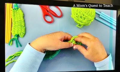 video screenshot of finishing the weaving using straws and yarn
