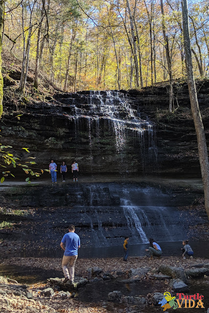 People enjoying the falls at the end of the Stillhouse Hollow Falls trail