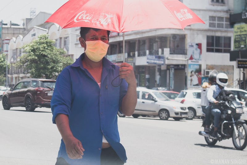 Angry Guy Under the Coca Cola Umbrella. - Took this Street Photography Shot on 21-May-2020 at Vaishali Nagar, Jaipur.
