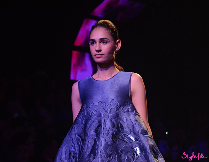 A model wears glitter on her eye lids and a low slung ponytail for Amit Aggarwal at Lakme Fashion Week Summer Resort 2016 at St. Regis, Mumbai