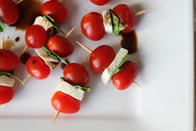 Summer appetizer recipe includes tomatoes and mozzarella cheese. #cookingfromscratch