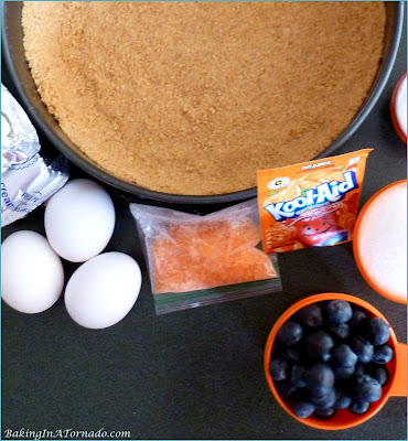 Orange Blueberry Cheesecake, bursting with orange flavor and studded with fresh blueberries.   Recipe developed by www.BakingInATornado.com   #recipe #dessert