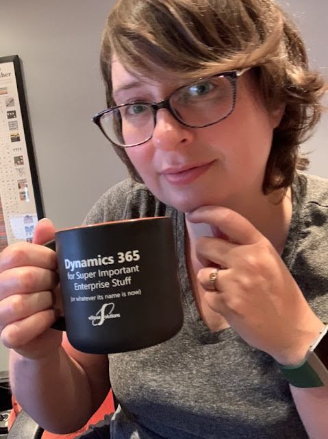 Kelly with her special Ellipse Solutions mug