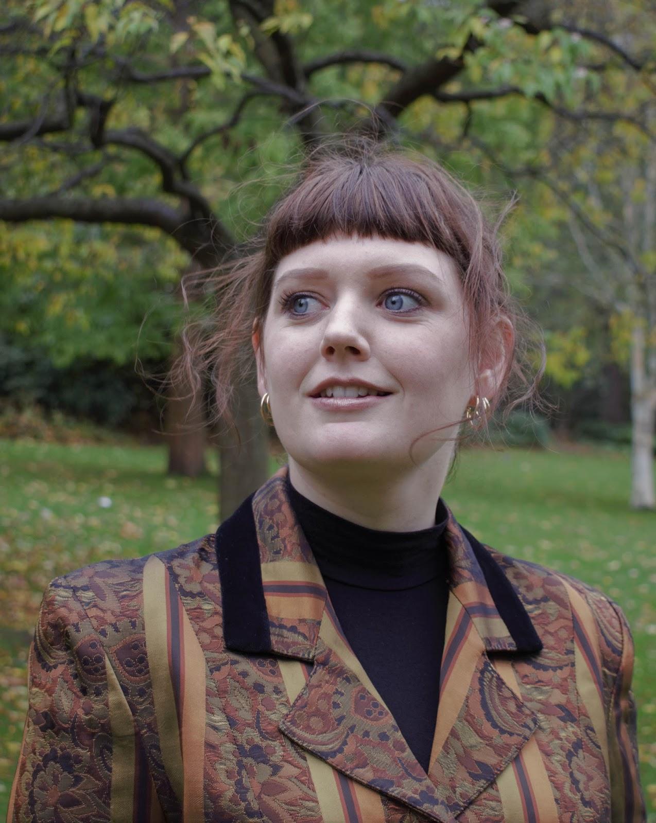 Scottish lifestyle blogger Lauren Aitchison from The Devil Wears Tartan portrait for Autumn in Princes Street Gardens