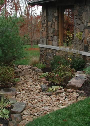 Dry River Creek Bed as pathways to the side of the house for garden interest