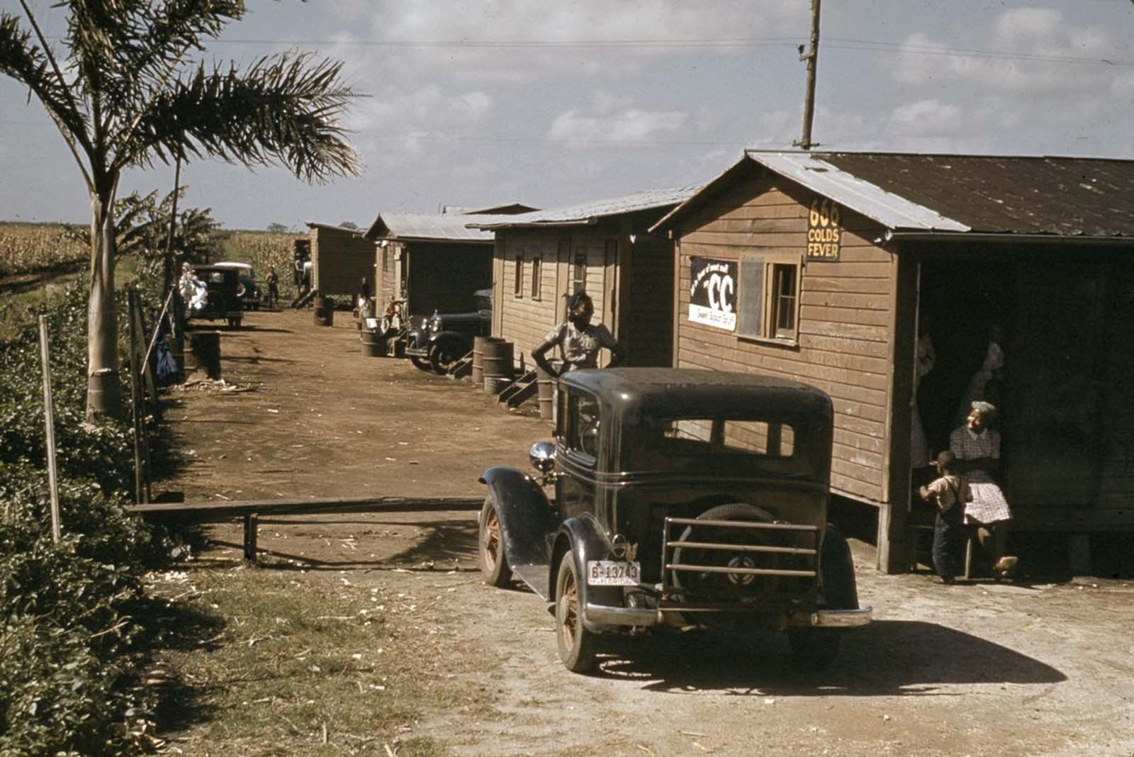Houses condemned by the Board of Health remain occupied by migrant sharecropper families in Belle Glade, Florida. 1941.