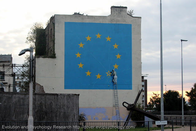 A 2018 photo of the Banksy Brexit Mural on the gable end of the former King's Arms Library. York Street in foreground, Snargate Street behind as is the A20 Townwall Street that carries on in front of the building to the Eastern Docks.