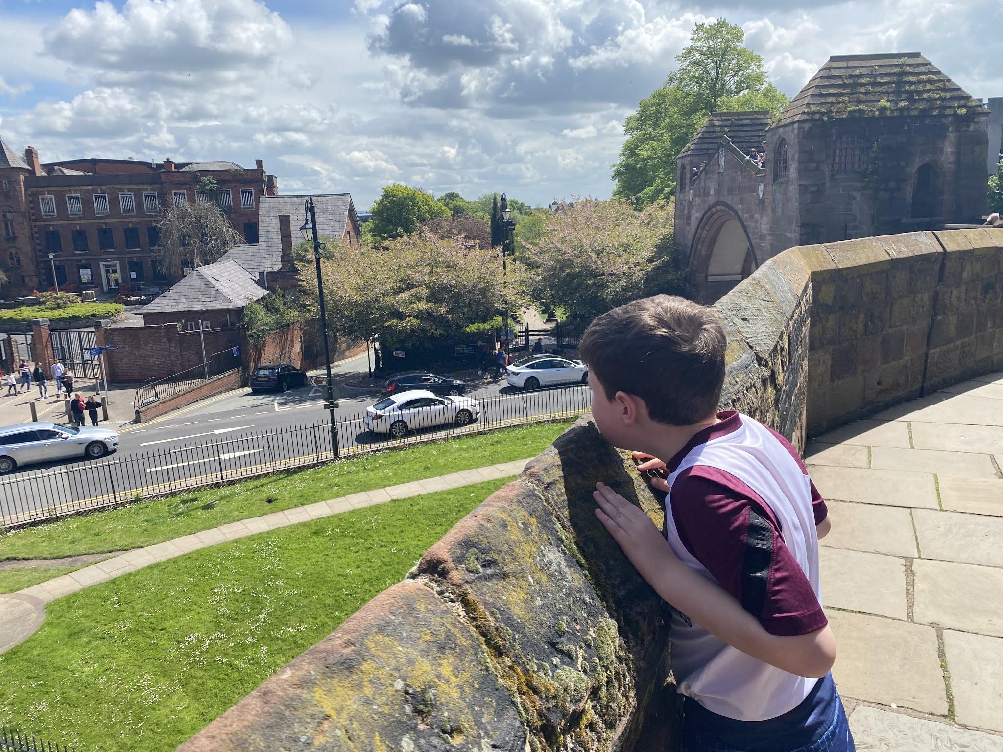 boy overlooking a wall