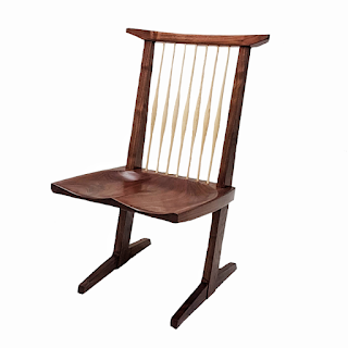 Image of a chair with ash spindles and walnut frame and seat