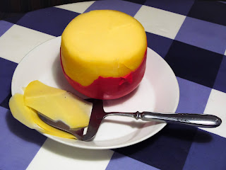 Edam is a semi-hard customarily sold in circles