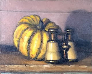 Still life oil painting of a yellow pumpkin beside a pair of opera glasses.