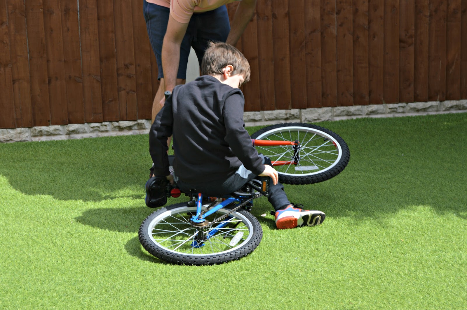Boy fell off his bike