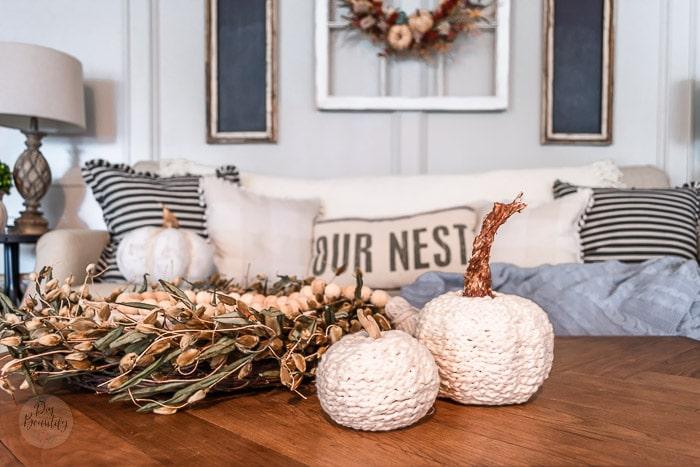 neutral sofa, black chalkboards, beaded wreath and crochet chain pumpkins