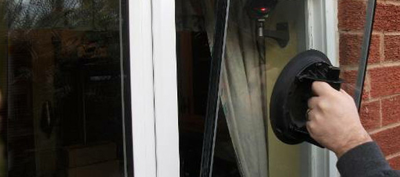 Employees installing glass windows
