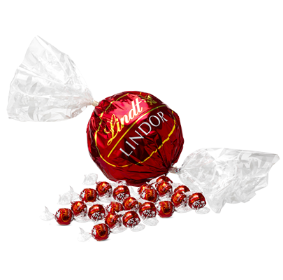A Lindt Maxi Ball alongside regular Lindt Balls