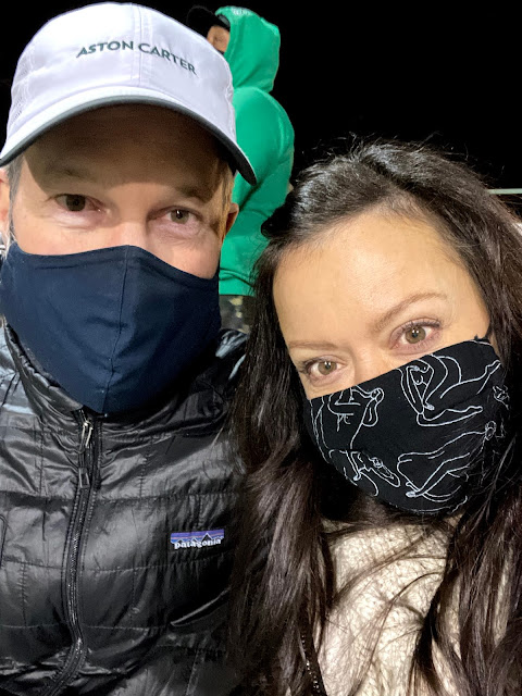 couple in masks at an outdoor event
