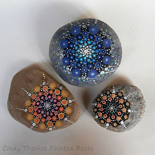 Mandala painted on stones using a dotting technique