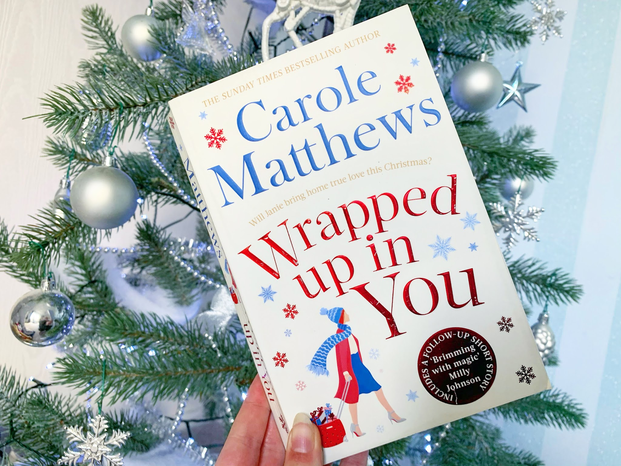 Wrapped Up in You by Carole Matthews book under the Christmas tree