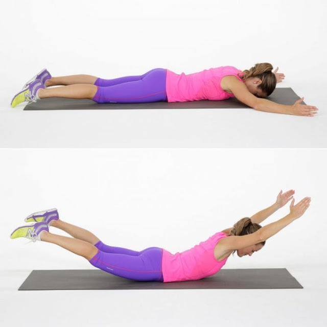Lift your hands and legs while lying on your stomach