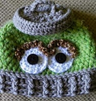 http://www.ravelry.com/patterns/library/grouch-in-a-can-hat--oscar-the-grouch-inspired
