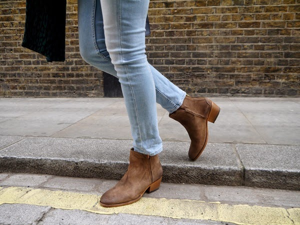 Suede boots and jeans in London