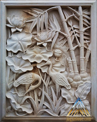 Relief bunga lotus dan bangau dibuat dari batu alam paras jogja (batu putih)