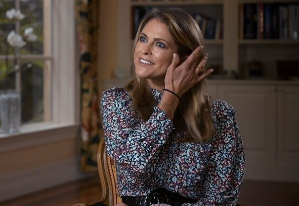 Princess Madeleine wore a wild blossom dress from By Malina, and pyramid hoops earrings from Sophie by Sophie, and rockstud espadrille from Valentino
