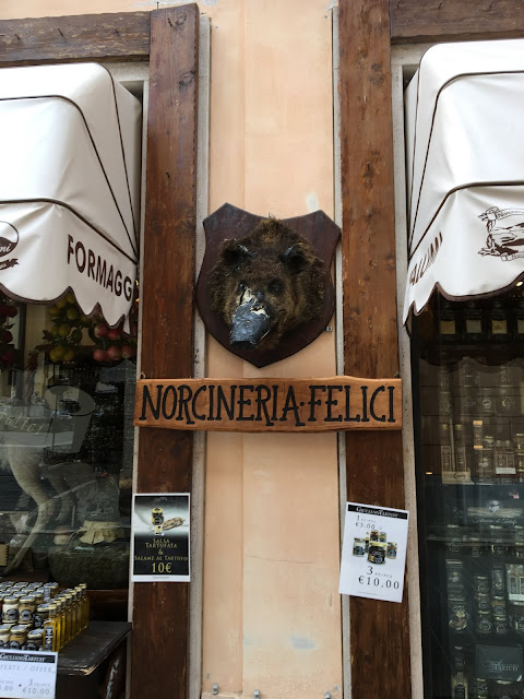 A butcher shop in Norcia selling norcineria, wild boar and pork.