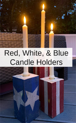 Candle holders with white lit candles